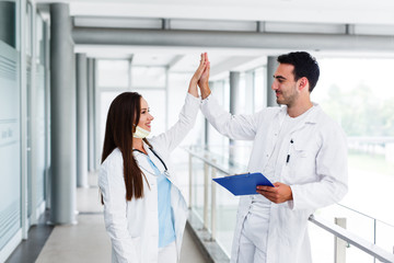 Doctors high five after successful surgery