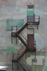 Fire stair at a green brick wall building