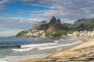 Famous Ipanema Beach with Dois Irmaos Mountains. Early morning light. Rio de Janeiro, Brazil