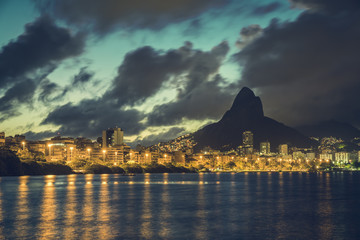 Rio de Janeiro skyline at dusk with dramatic clouds on sky. Brazil