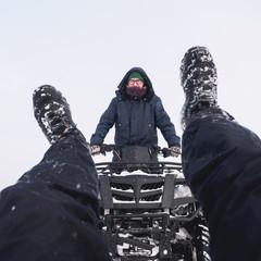 Man accident in atv quad bike. Winter snow field
