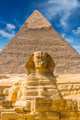 Photo sur cadre textile Egypte Egyptian sphinx. Cairo. Giza. Egypt. Travel background. Architectural monument. The tombs of the pharaohs. Vacation holidays background wallpaper