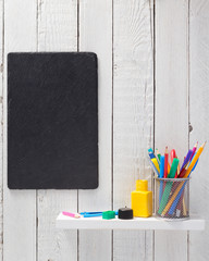 school supplies and tools at wooden shelf