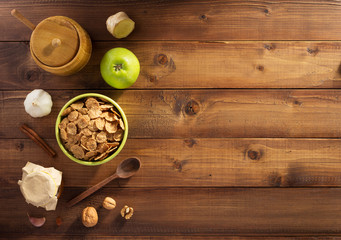 cereal flakes and healthy food on wood