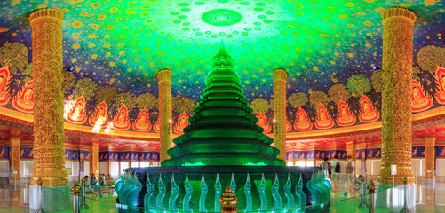 In de dag Temple Golden pagoda with lighting inside at Wat Paknam Bhasi Charoen