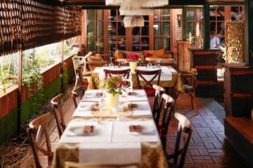 Setting tables in retro designed restaurant
