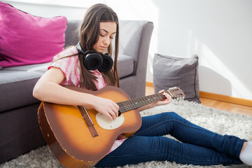 woman play acoustic guitar