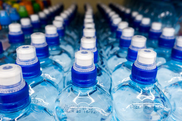 plastic bottles with water, caps, drinks