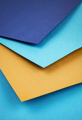 a group of colored papers