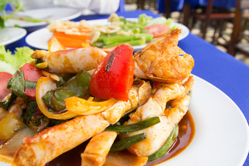 Stir fries crab with chilli