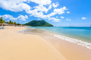 Reduit Beach - Tropical coast on the Caribbean island of St. Lucia. It is a paradise destination with a white sand beach and turquoiuse sea.
