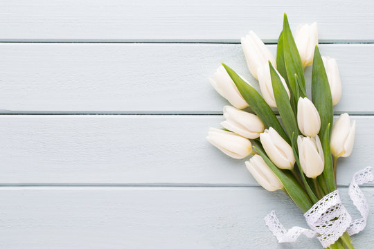 Mother's Day, woman's day, easter, white tulips, presents on gray  background.