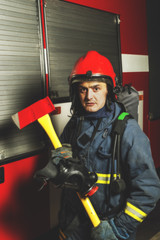 Firefighter with a tool