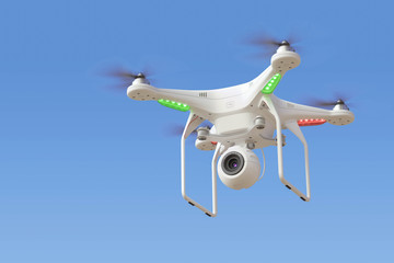 Quadcopter drone with camera in blue sky