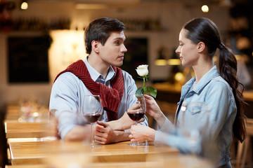 Lovely couple celebrating Valentine's Day at restaurant