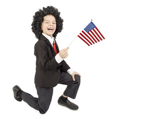 Funny curly-haired brunette boy with an American flag, isolated on white