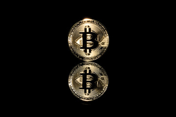bitcoin on black background with reflection