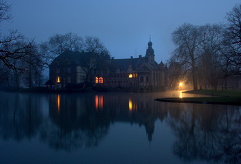 Winter Castle By Lake At Night