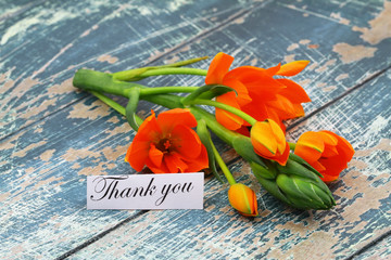 Thank you card with orange flowers on rustic wooden surface