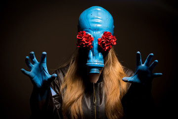 Girl with a gas mask on a grey background