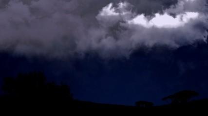 Summer storm beginning with lightning at night time, beautiful phenomenon