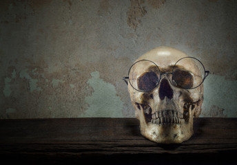 Skull Glasses On old wood floor.