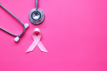Pink ribbon and stethoscope on pink background, Symbol of breast cancer in women, Health care concept