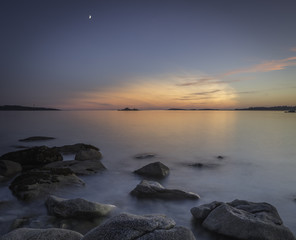 Moonset over sunset - landscape