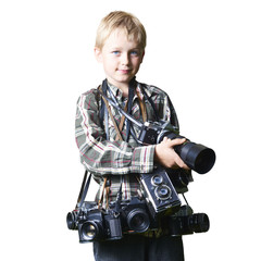 Child boy photographer with many cameras around his neck. Photographer enthusiast