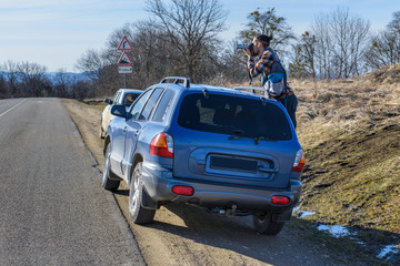 Photographer takes pictures from the car