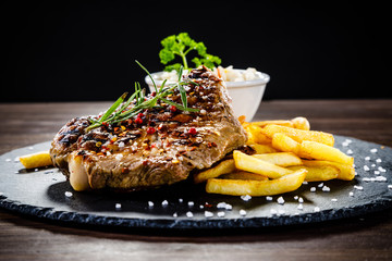 Printed roller blinds Steakhouse Grilled steak with french fries and vegetables served on black stone on wooden table