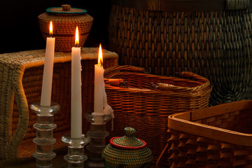 Lighted candles and baskets