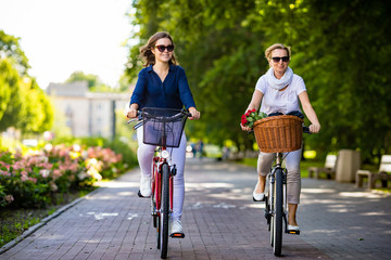 Women biking in city park