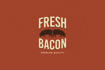 Emblem of Butcher shop with picture of silhouettes two pigs and writing fresh bacon premium quality. Design elements for meat stores, packaging and advertising. Vector Illustration.