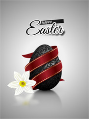 Black mat realistic egg with metallic floral pattern diagonal wrapped red ribbon. Gray background with reflection and white narcissus flower. Bright greeting card with Happy Easter text.