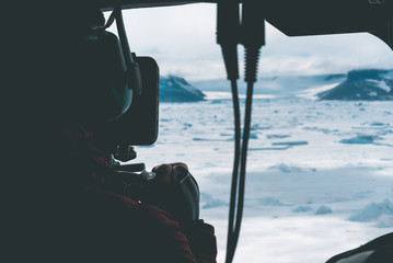 Filmmaker filming the Landscape - Antarctica