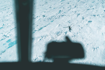 Air to Air View of Helicopter over the Ice - Antarctica