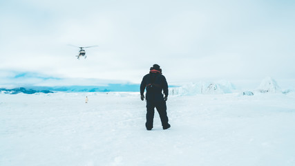 Helicopter approaching the Sea Ice - Antarctica
