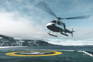 Helicopter departing Expedition Vessel - Antarctica