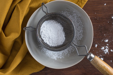 Sifting powdered sugar