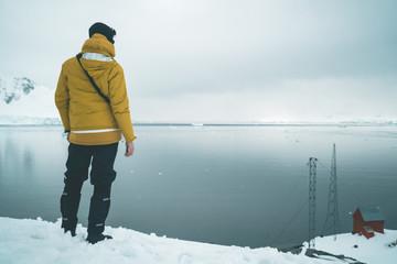 Man enjoying the Brown Station Panorama - Antarctica