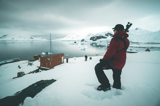 Photographer standing above Brown Station - Antarctica
