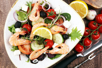 tasty meal with fresh and healthy prawn salad and vegetables. Prawns Langostino Austral.