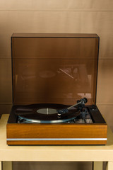 Vintage turntable playing a vinyl record