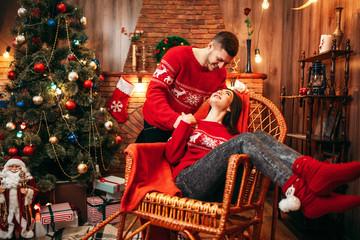 Happy love couple celebrate christmas holidays