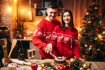 Love couple tastes christmas cake, festive food