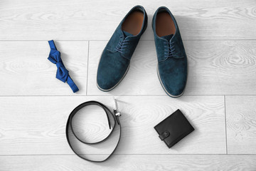 Composition with stylish men's  shoes on floor