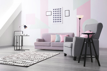 Living room interior with comfortable sofa and armchair