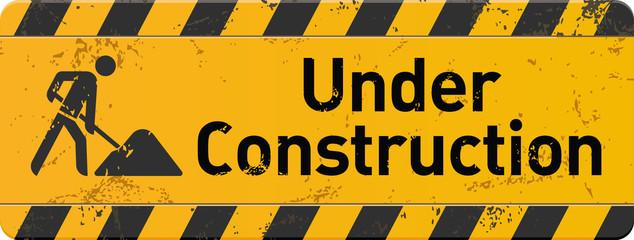 gelbes Schild under construction mit Bauarbeiter-Icon