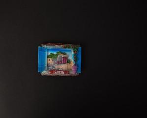 Souvenir - Fridge magnet from Crete Island, Greece on black background